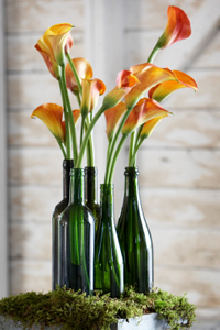 flowers moss green bottles 10 Cool Spring Centerpieces