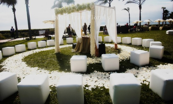 White seating provides an elegant, uniform look that makes the most of the natural floral and greenery, also it gives a unified look to the ceremony decor.