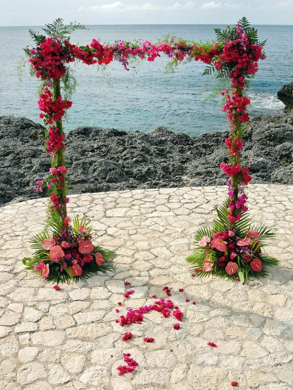 opt to decorate the wedding arches with seasonal flowers like daisies, hydrangea, and roses.