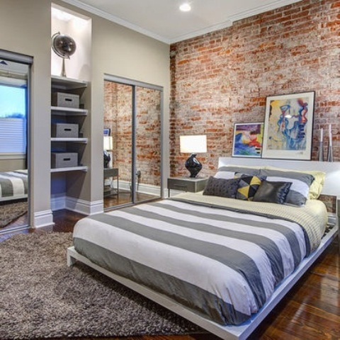 Designer bedrooms with exposed brick walls for Brick wallpaper bedroom ideas