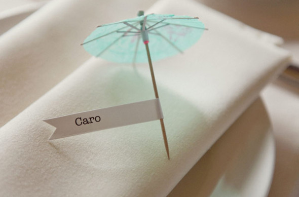 Cocktail umbrellas are perfect to be used as place card in place setting