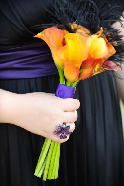 this simple bouquet of Orange calla lilies, black feathers and purple ribbon is perfect.