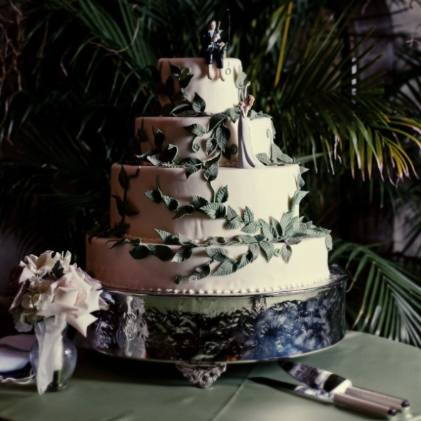 If the theme is rustic, fondant leaves add rustic charm to this elegant cake.