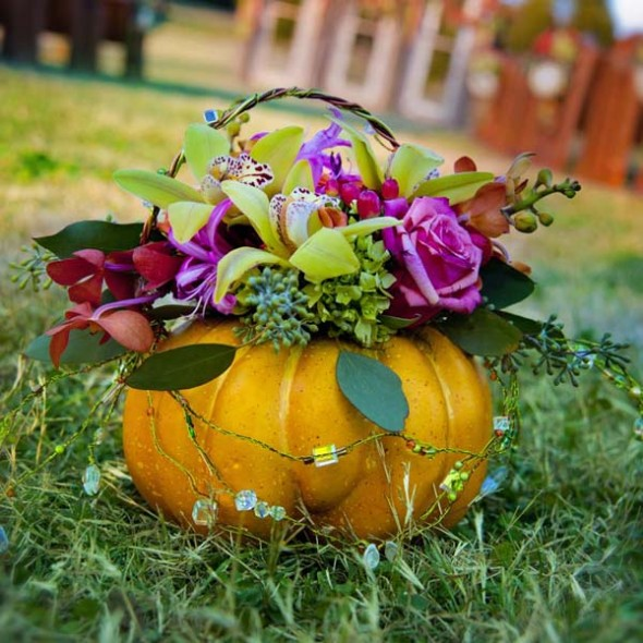 a flower- filled faux pumpkin is an adorable addition to decor