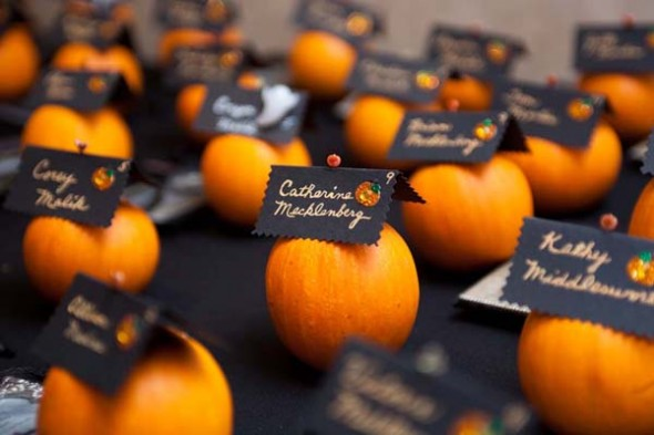 Attach escort cards to mini pumpkins, they add a flair to the overall theme.