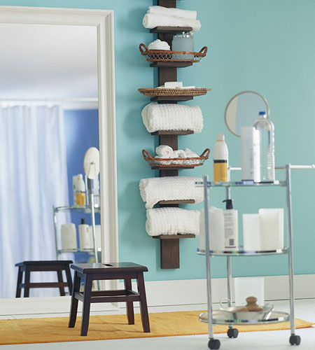 Think vertically when planning storage in a small bathroom.