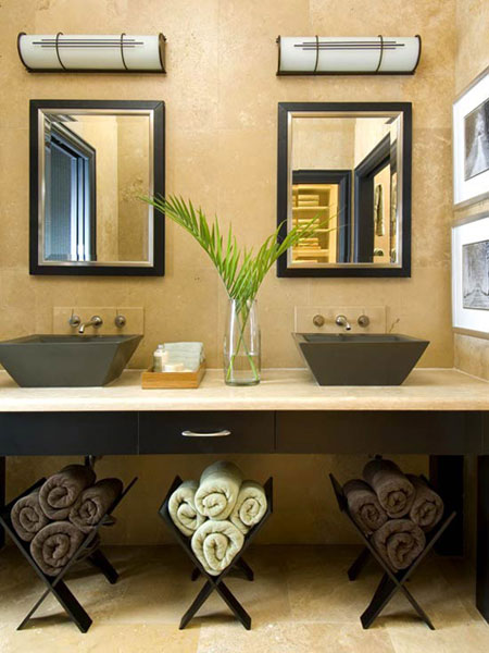 Use the open area under the sink to store, roll up towels and place them in contemporary wooden magazine racks