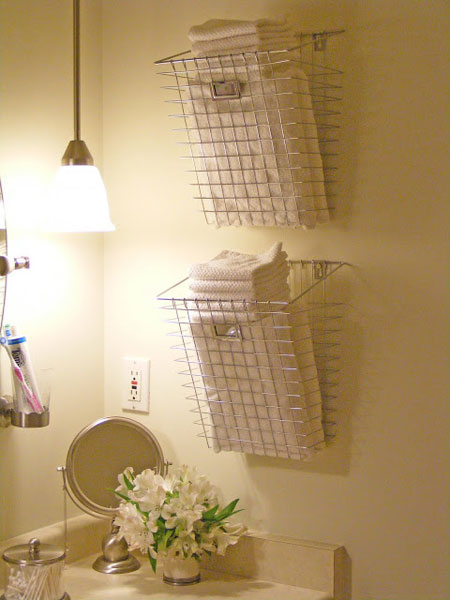 Displaying  towels in sleek chrome baskets will add on to overall theme.