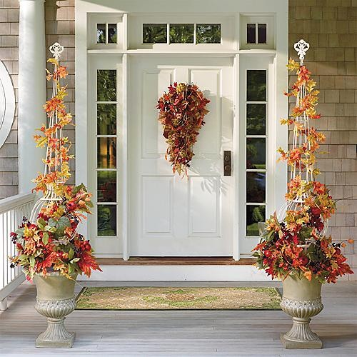 Decorate your home exterior with cornucopia of fresh decorating ideas. Be it Thanksgiving or Christmas a colorful flower arrangement can never go wrong.