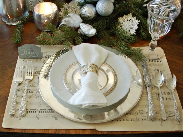 Top the music with a silver charger an ironstone dinner plate and a silver bread plate. Then roll up a monogrammed linen napkin in a simple silver ring. & Christmas Table Decoration Ideas