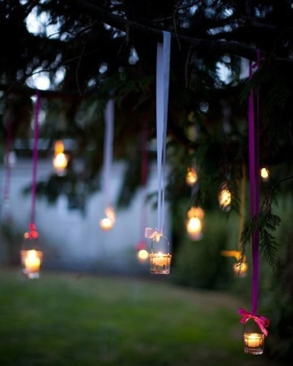 hang tea lights from a tree with colorful ribbons and pretty bows