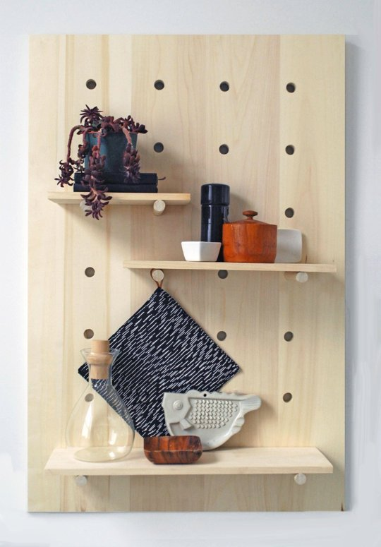 Pegboard racks can get your belongings organized while keeping them from taking up your limited floor or counter space.