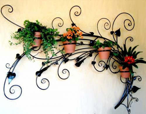 Using A Wrought Iron Planter Gives Neat And Rustic Look Outdoors You Can Choose From Number Of Designs Shapes Available Longevity Is Another Feature